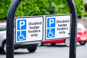 Blue badge sign stating disabled badge holders only.