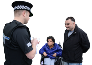 Two people reporting a crime to a Police Officer